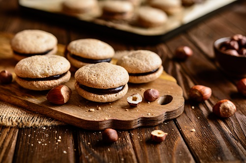 Delicious hazelnut shortbread sandwiches filled with chocolate cream